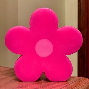 Pink flower-shaped candle
